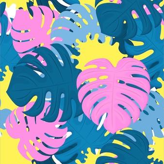 Liście monstery i plamy z farby. tropikalny wzór. modny wzór.