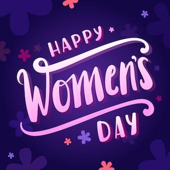 Literowanie dzień kobiet na ciemnym niebieskim tle
