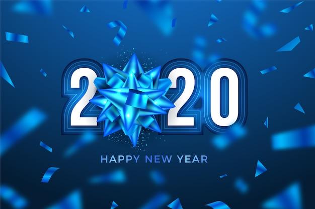 Lód nowy rok 2020 tło z kokardą śnieżynka