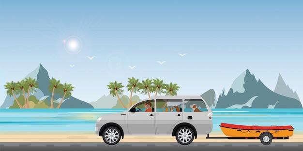 Łódź holuje samochód na drogowym bieg wzdłuż dennego wybrzeża.