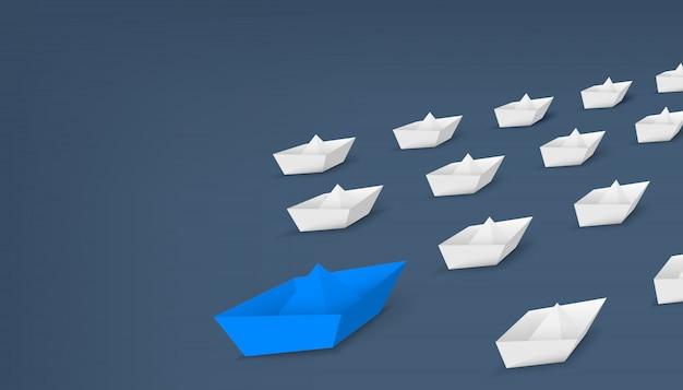 Łódź z czerwonego papieru lidera, statek prowadzący wśród.