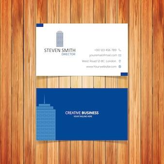 Logo budynku minimalna wizytówka korporacyjna z białym froncie i niebieskim tyłem