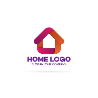 Logo domu w kolorze pomarańczowym i czerwonym na białym tle