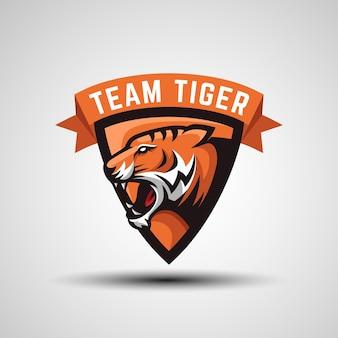 Logo emblematów twarzy tygrysa z tarczą dla szablonu logo drużyny e-sportowej lub logo gier