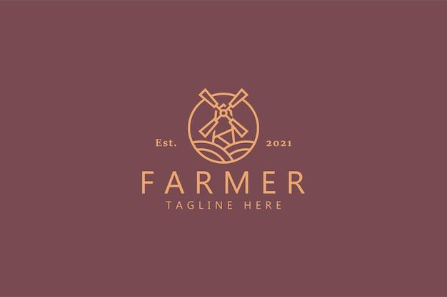 Logo farmera kraju wiatrak na białym tle na miękkiej czerwieni