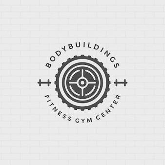 Logo fitness lub odznaka ilustracja okrągły sprzęt sportowy sztangi sylwetka symbol