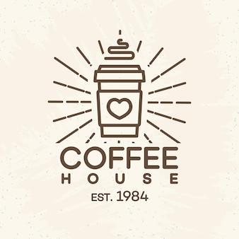 Logo kawiarni z papierowym kubkiem stylu linii kawy na białym tle na tle kawiarni