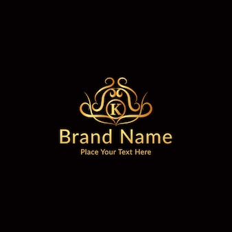 Logo litery k ze złotymi ornamentami