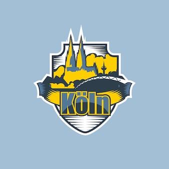 Logo miasta kolonia w dwóch kolorach.