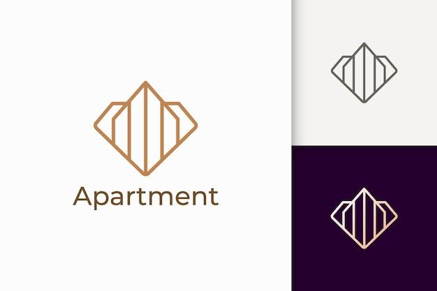 Logo mieszkania lub nieruchomości w kształcie rombu dla branży nieruchomości