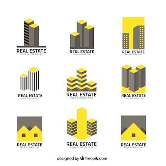 Logo nieruchomości w kolorze szarym i żółtym