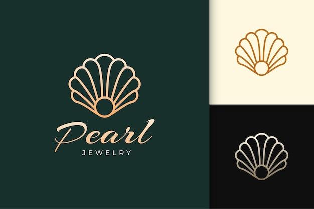 Logo perły lub biżuterii w luksusowym i eleganckim dopasowaniu do branży kosmetycznej lub kosmetycznej