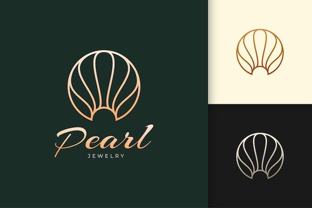 Logo perły lub biżuterii w luksusowym i eleganckim stylu reprezentuje piękno i modę