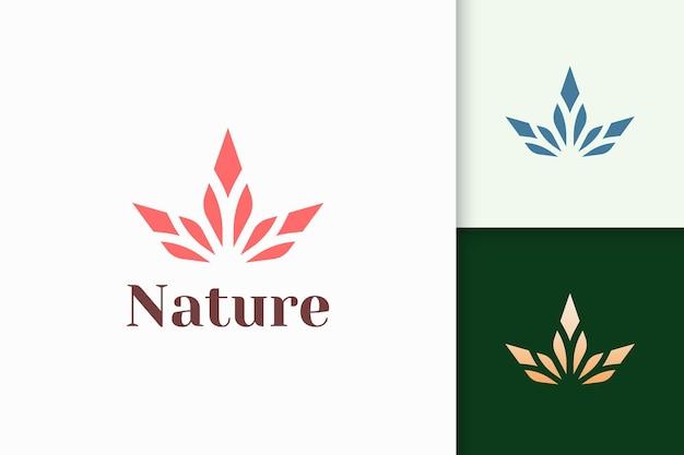 Logo piękna w abstrakcyjnym kształcie kwiatu