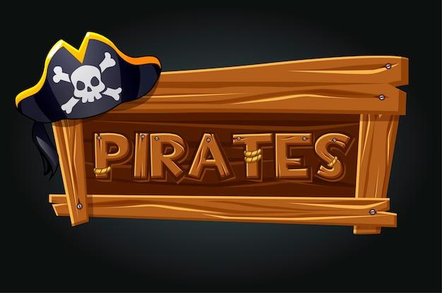 Logo piratów na starej drewnianej desce. logo gry, piracka czapka na szarym tle.