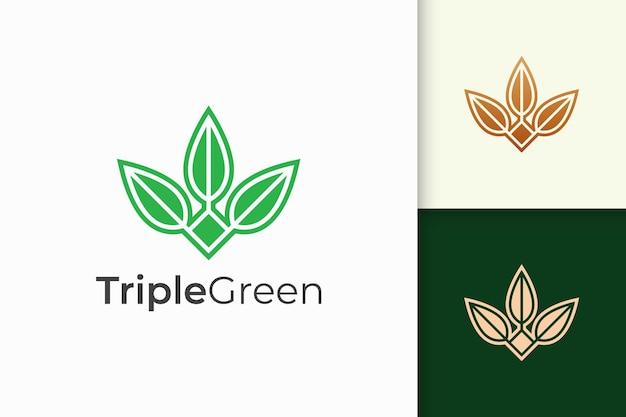 Logo potrójnego liścia lub kwiatu w kobiecym i luksusowym stylu dla zdrowia i urody