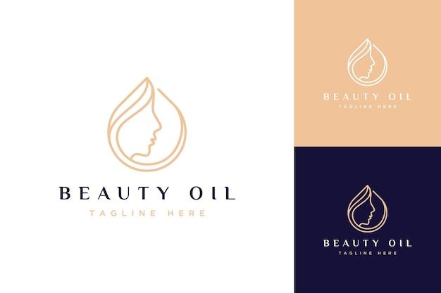 Logo projektu kosmetycznego lub krople oleju z twarzą kobiety