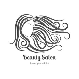 Logo salonu piękności. kobieta z długimi włosami