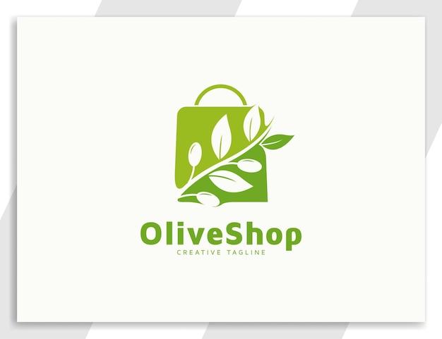 Logo sklepu z zieloną oliwą z oliwek z liśćmi i ilustracją torby na zakupy