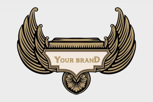 Logo skrzydła anioła, ozdobny element w stylu barokowym.