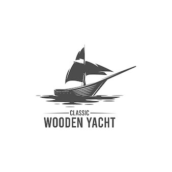 Logo sylwetka klasycznego drewnianego jachtu