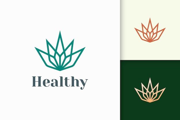 Logo urody lub zdrowia w kształcie kwiatu nadające się do produktu witaminowego lub serum