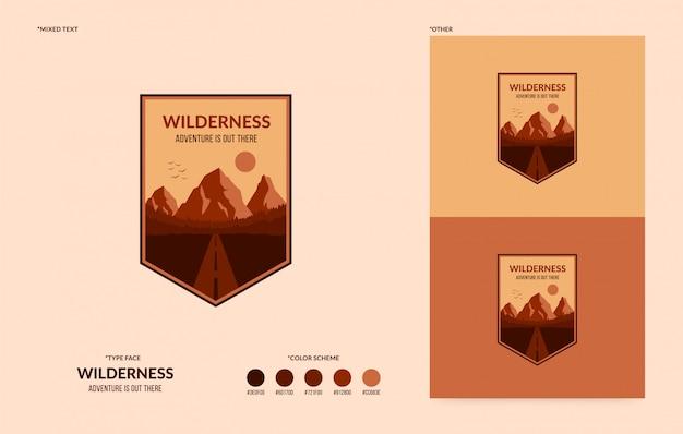 Logo wilderness, odznaka przygodowa na świeżym powietrzu, koncepcja turystyki pieszej i kempingu