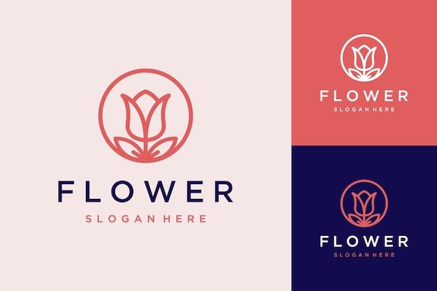 Logo z motywem kwiatowym z kółkiem