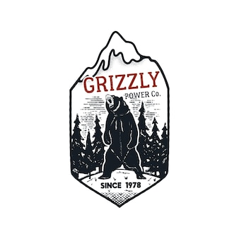 Logo znaczka mocy grizzly w stylu vintage