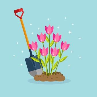 Łopata z kwiatami na niebieskim tle