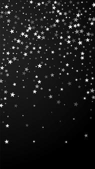 Losowe spadające gwiazdy boże narodzenie w tle. subtelne latające płatki śniegu i gwiazdy na czarnym tle. niesamowity szablon nakładki zimowego srebrnego płatka śniegu. znakomita ilustracja pionowa.