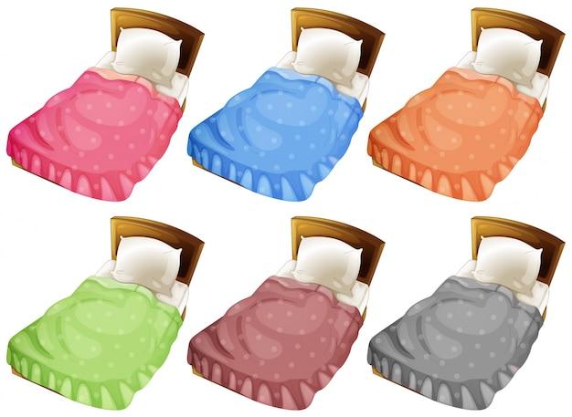 Łóżka z sześcioma kolorowymi kocami