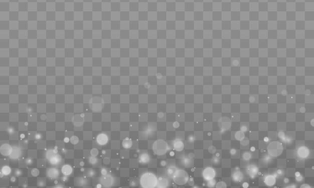 Lśniące magiczne cząsteczki kurzu. efekt bokeh. pył gwiezdny iskrzy podczas eksplozji. białe iskry błyszczą specjalnym efektem świetlnym. biały brokat tekstura tło boże narodzenie.