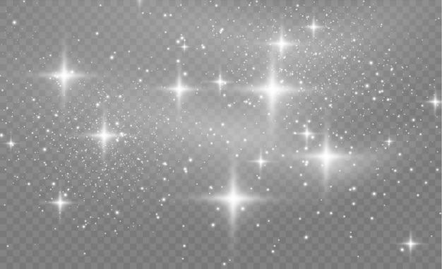 Lśniące magiczne cząsteczki kurzu. pył gwiezdny iskrzy podczas eksplozji. białe iskry błyszczą specjalnym efektem świetlnym. biały brokat tekstura tło.