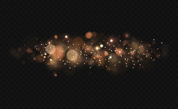 Lśniące magiczne cząsteczki pyłu. efekt bokeh światła jest izolowany na przezroczystym tle. żółty pył, żółte iskry i złote gwiazdy świecą specjalnym światłem.