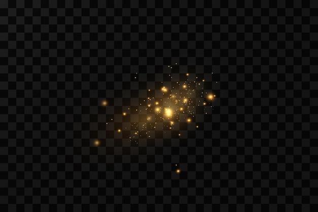 Lśniące magiczne cząsteczki pyłu, iskry pyłu i złote gwiazdy lśnią specjalnym światłem