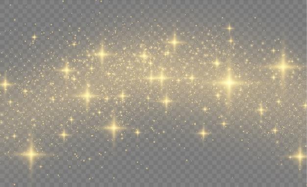 Lśniące, magiczne cząsteczki pyłu, żółty pył, żółte iskry i złote gwiazdy lśnią specjalnym światłem.