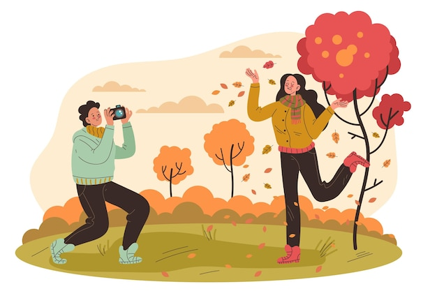 Ludzie bawią się jesienią
