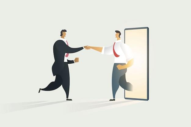 Ludzie biznesu drżenie rąk poprzez współpracę na wyświetlaczu telefonu komórkowego.
