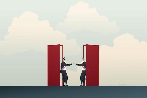 Ludzie biznesu podają sobie ręce przez dwoje czerwonych drzwi uzgodnili wspólne prowadzenie interesów