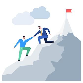 Ludzie biznesu wspina się na lidera górskiego pomagając koledze osiągnąć cel