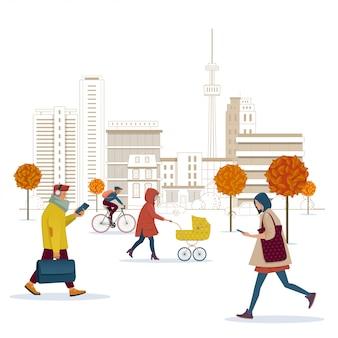 Ludzie chodzą ulicą jesiennego miasta