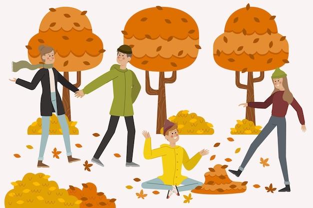 Ludzie chodzą w parku jesień