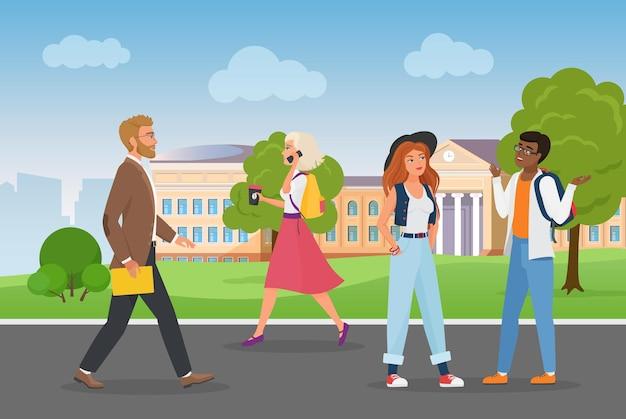 Ludzie chodzą w pobliżu kampusu uniwersyteckiego w krajobrazie miasta, młodzi studenci rozmawiają pieszo