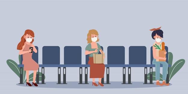 Ludzie covid-19 dystansują się w miejscach siedzących. nowy normalny styl życia w codziennym życiu po wybuchu koronawirusa.