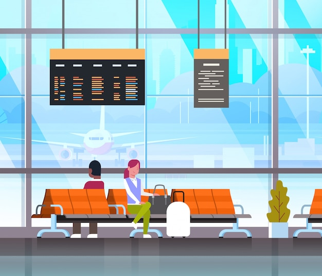Ludzie czekają na start w hali lotniska