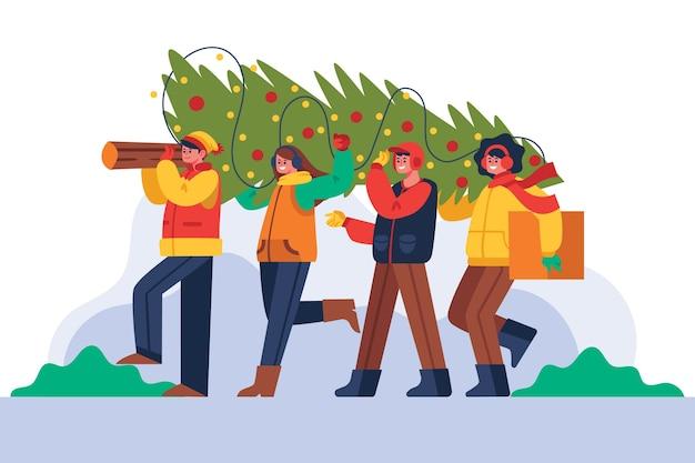 Ludzie dekorujący choinkę