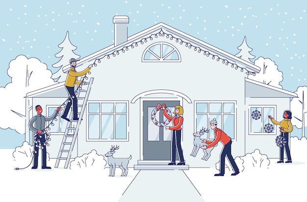 Ludzie dekorujący dom i ogród na boże narodzenie i nowy rok na świeżym powietrzu.