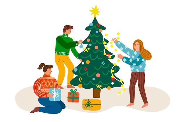 Ludzie dekorujący świąteczne drzewo