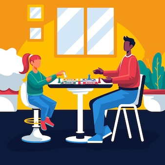 Ludzie grający w grę ludo przy stole